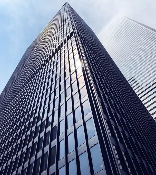 low-angle-photo-of-building-2516426